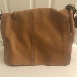 Tan Coach brand shoulder purse